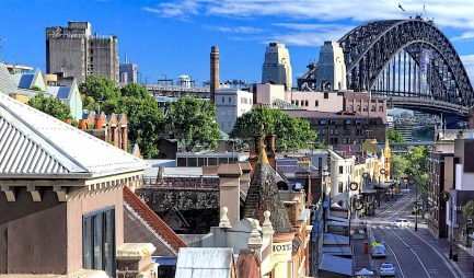 SYDNEY, AUSTRALIA - DECEMBER 1 2013; Early morning streetscape view of a part of the city of Sydney known as The Rocks. With Sydney Harbour Bridge.